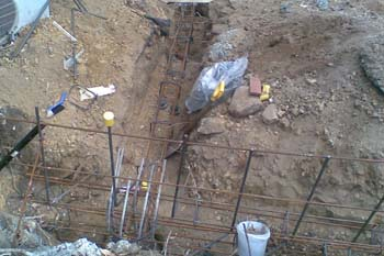 Trenches with reinforcement for strip footing