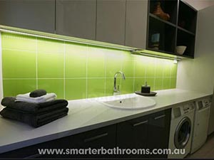 Green tiles with white grout. Smarter Bathrooms Melbourne